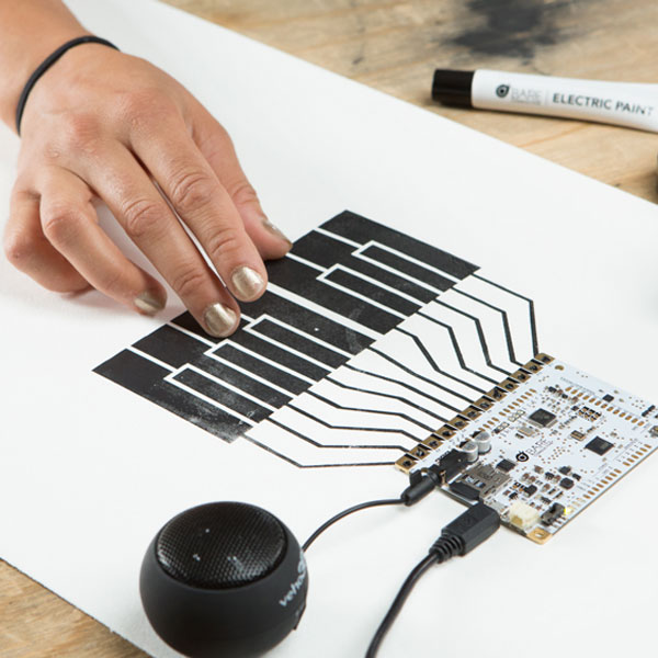 Electric paint keyboard connected to a touch board
