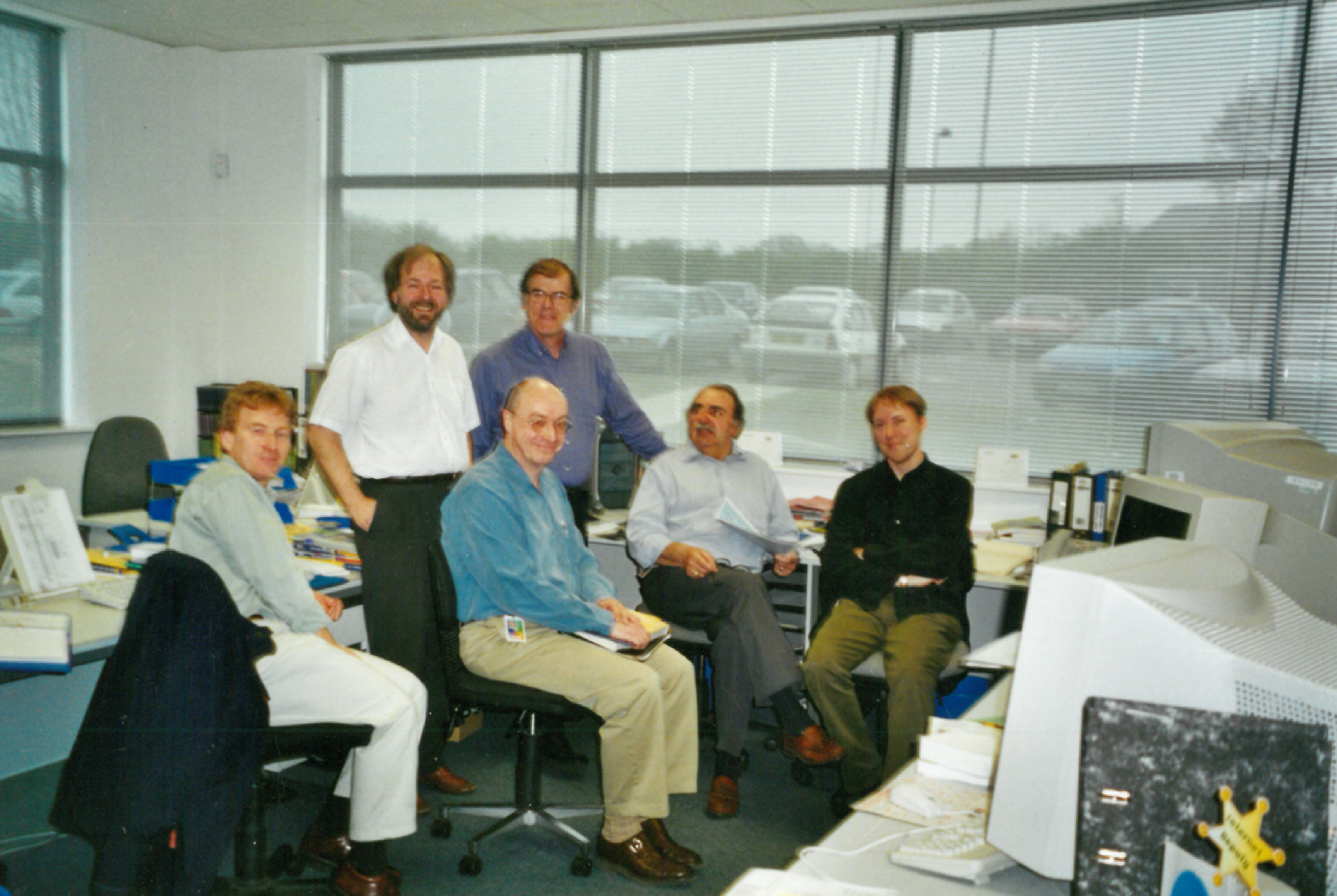 John Blanchard, 2nd from left (standing), with the Catalogue Production team in 2000.
